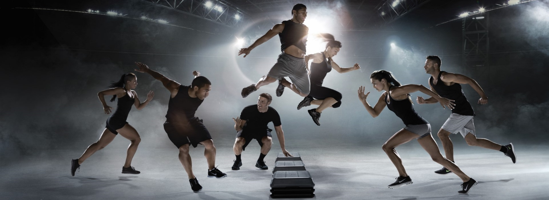 Les Mills grit plyometrics with coach encouraging 3 males and 3 females to run faster and jump higher